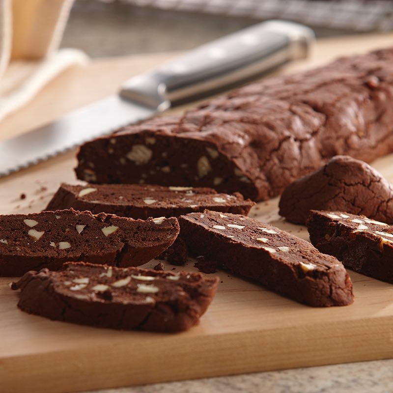 The fully-baked cookie logs are sliced into biscotti, then re-baked at a low temperature to finish drying.