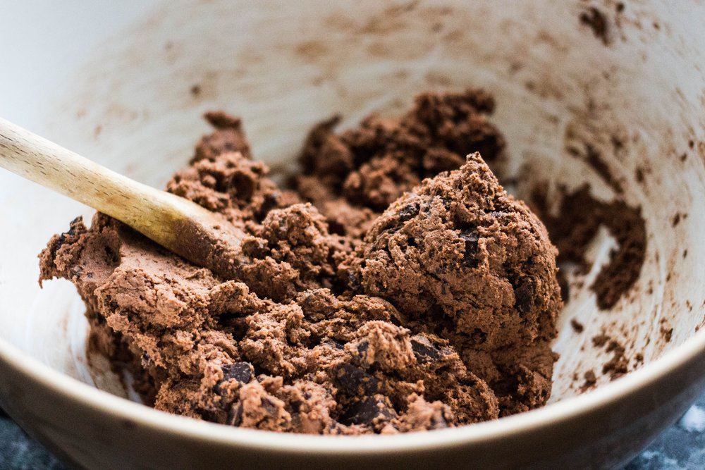 Once the flour is added, only mix until barely combined. Over-mixing will yield tough cookies.