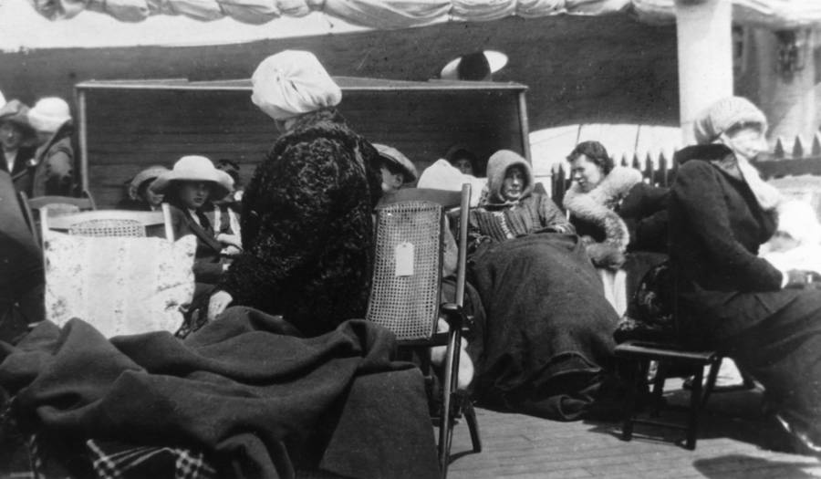 Survivors of the  Titanic  huddled under blankets and coats on the deck of the  C  arpathia
