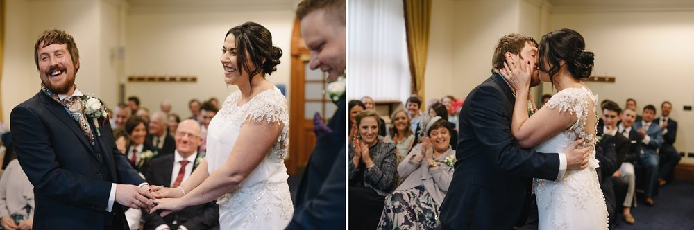 first kiss of bride and groom at Sheffield Town Hall wedding