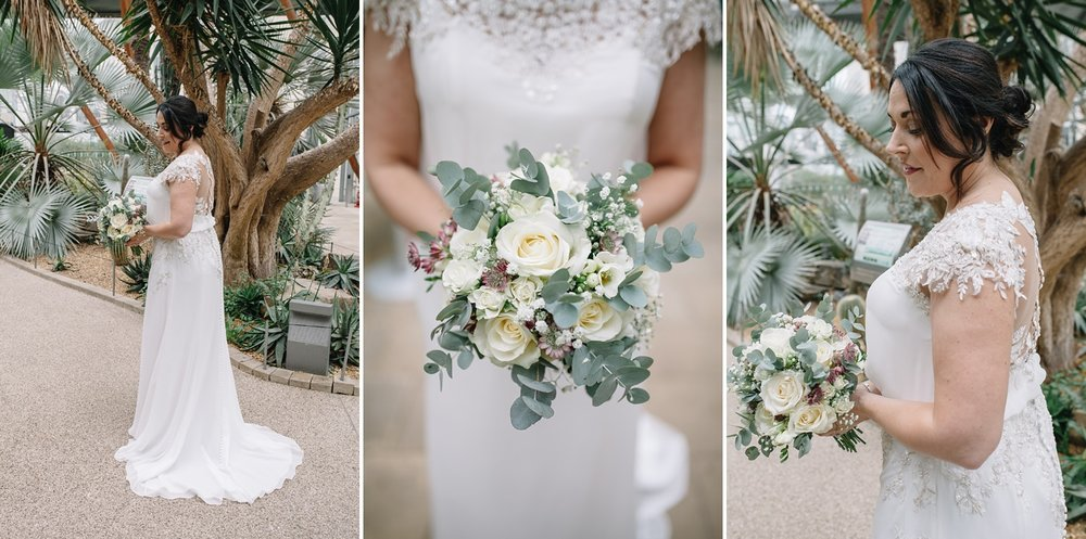 Sheffield wedding photography of beautiful bride and her bouquet stood in Sheffield Winter Gardens
