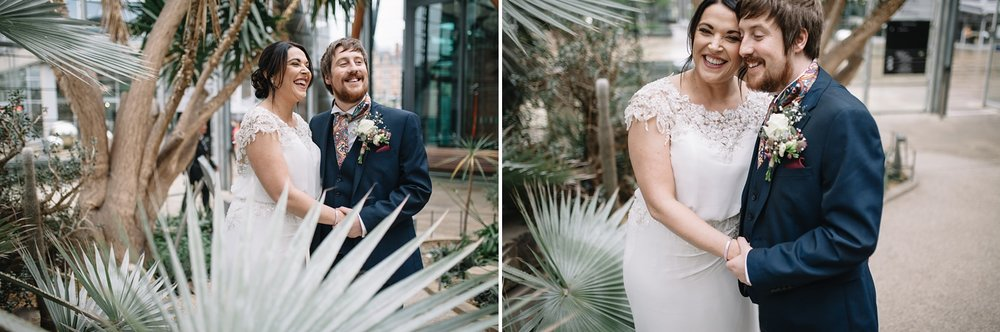 bride and groom laughing in the Winter Gardens Sheffield