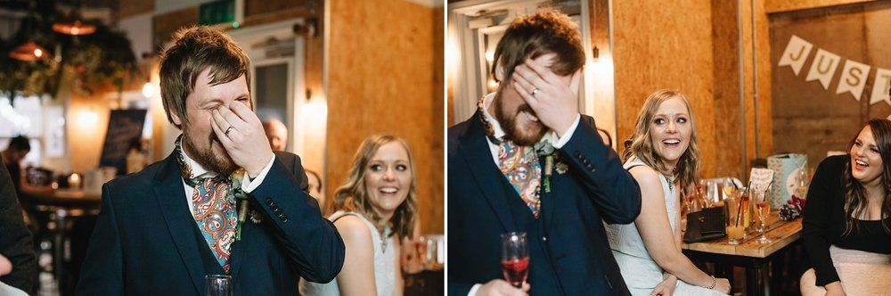 Embarrassed groom with head in hands