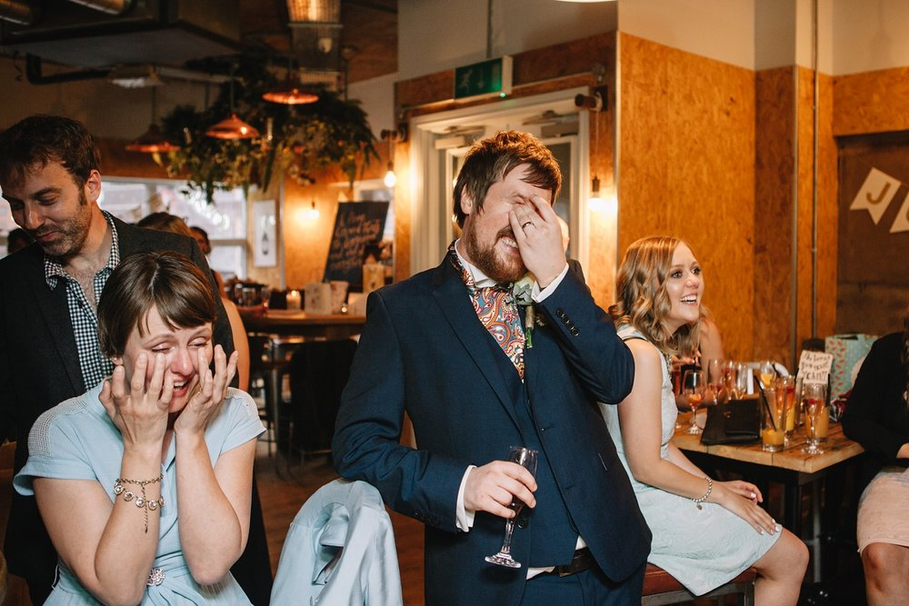 groom embarrassed laughing at speeches