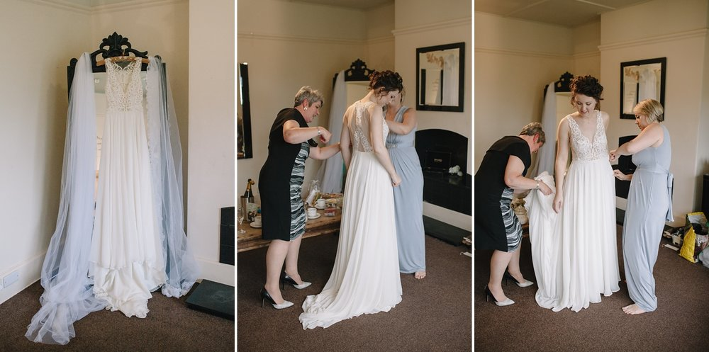 bride getting ready into her wedding dress at Whirlowbrook Hall