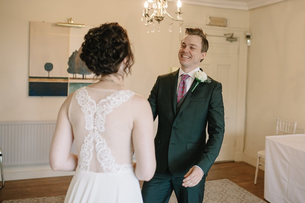 bride smiling at seeing his bride for the first time