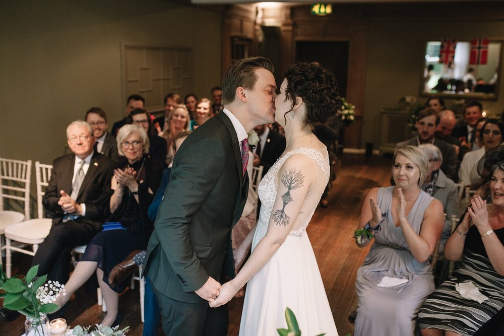 first kiss of bride and groom at Whirlowbrook Hall wedding