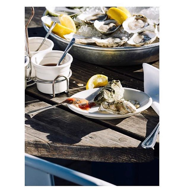 Not much better than a sunny day, a dozen oysters and 🍸 #foodphotography by @travishallmark for @texasmonthly