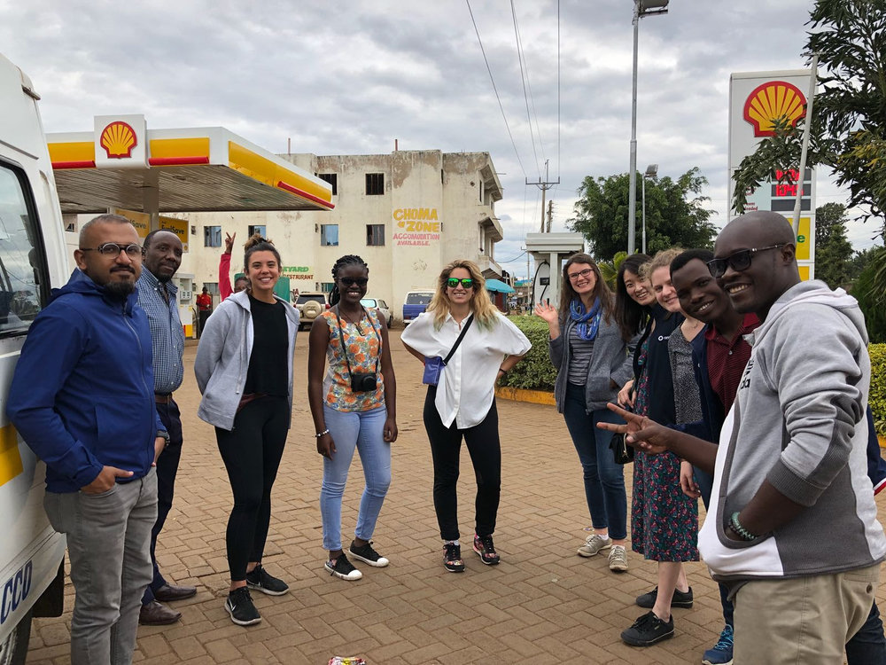 Photo of participants and one of our organizers, Stella, while taking a break at a filling station in Mwea.