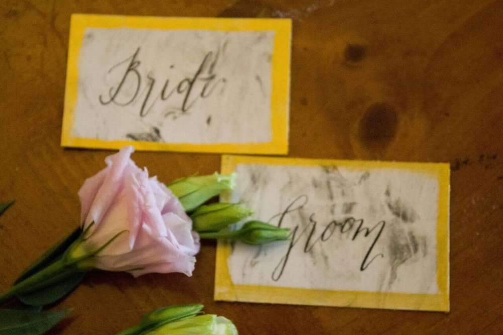 lace names hand crafted by Merrie & bright stationery complimented the tablescape along with the gold cutlery and gold feather napkin ties.