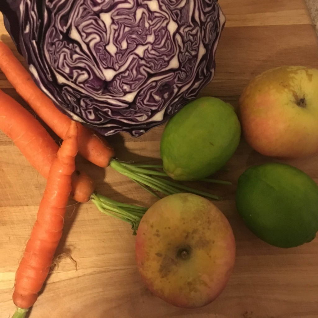 ingredients for salad: cabbage, carrots, limes, apples