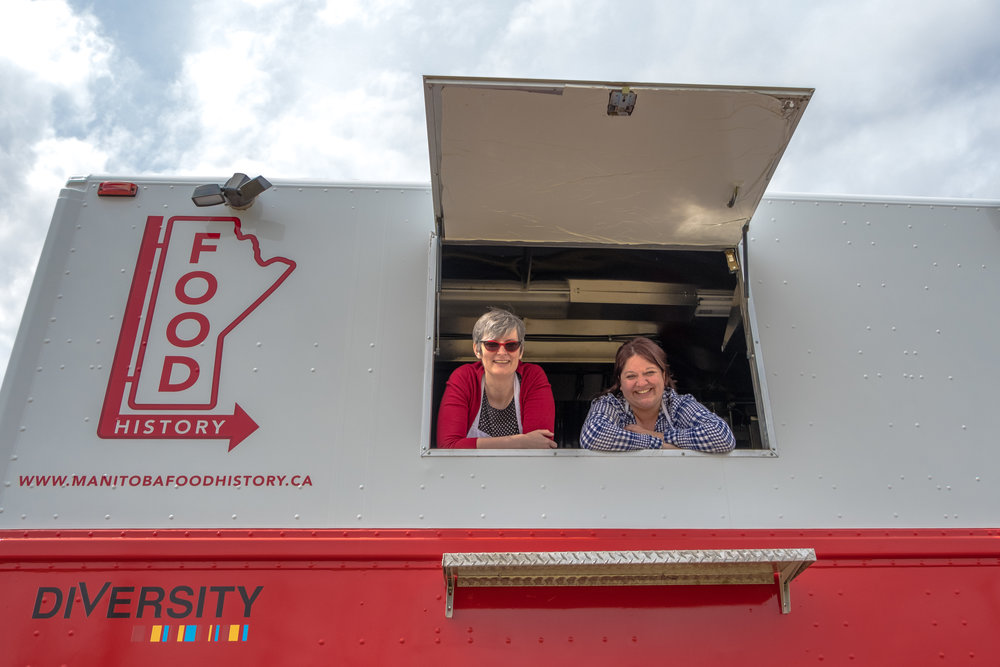 Janis Thiessen and Sarah Story on the Manitoba Food History Truck