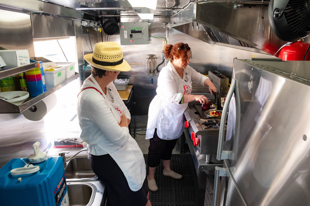 Janis Thiessen and interviewee Karen Peters cooking on the Manitoba Food History Truck. Photo by Kimberley Moore.