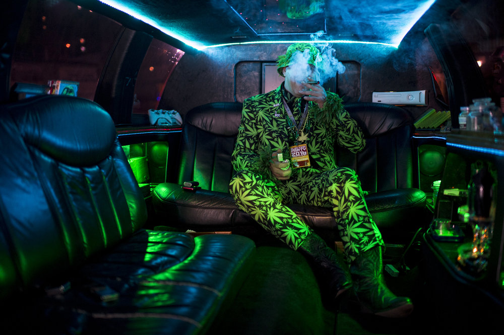 "Mike ""Big Mike"" Barnes takes a puff from his marijuana pipe in his privately owned ""420 limo"" to celebrate the legalization of recreational pot in California at an election party hosted by the Berkeley Patients Group for proposition 64 at The New Parish club in Oakland, Calif."