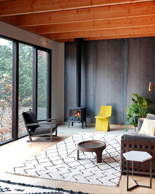 An interior shot of the coach house, showing off the beautiful exposed Douglas fir members and fireplace. The following images show custom metal details for the handrail and cabinetry to contrast the white oak. The handles were custom cut to the shape of train tracks. . . . #setlessarchitecture #architecture #toronto #torontodesigner #moderndesign #modernarchitecture #interiordesign #wood #douglasfir #furniture #details #metal #custom