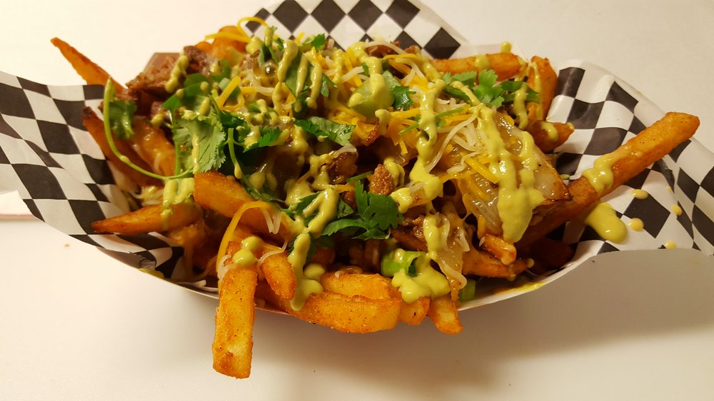 MEXICAN FRIES A bead of seasoned battered fries with melted homemade queso topped with Mexican beef and pork fajitas steak, grilled bell peppers and onions, cheddar and monterey cheese, green onions, cilantro and o    ur mouth watering Mexican hot green salsa.