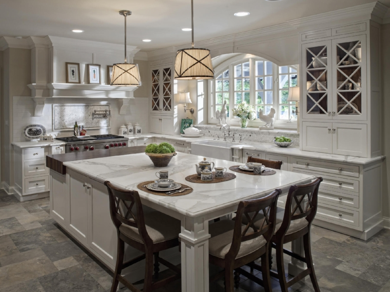 Two symmetrically-placed pendants light a kitchen island and mimic the stylistic elements of the space.