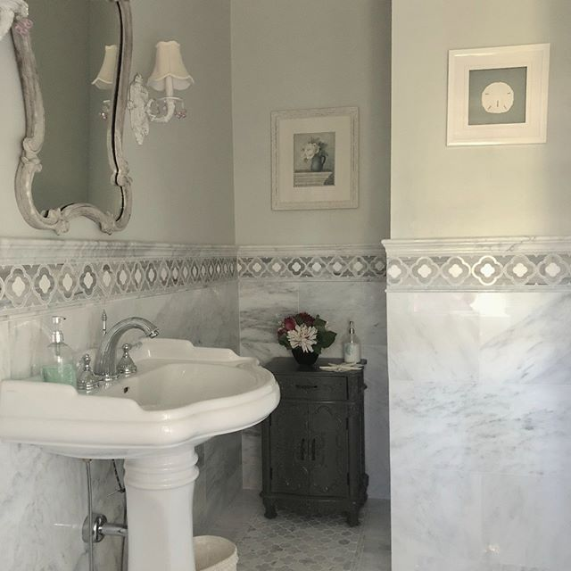 Love the new marble design  in this small but elegant powder room . Keep in mind that even small changes can make a huge impact. #powderroom  #bathroomdecor #grayandblue #homedecor #designtosell #realtor #njmom #myhousebeautiful #ilovemyhome #smallspaces #happywednesday #tilefloor #tiledesign #lighting #homegoods #homegoals #hgtvdreamhome #dreamroom #bathroom