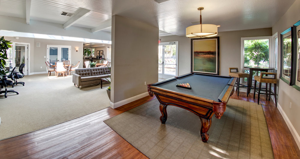 Clubhouse with pool deck and spa