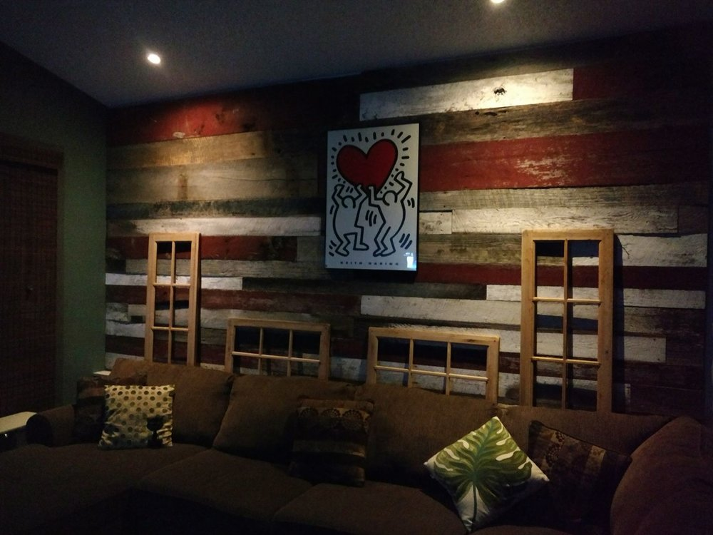 Antique barn wood accent wall cover using a mix of red white and brown boards