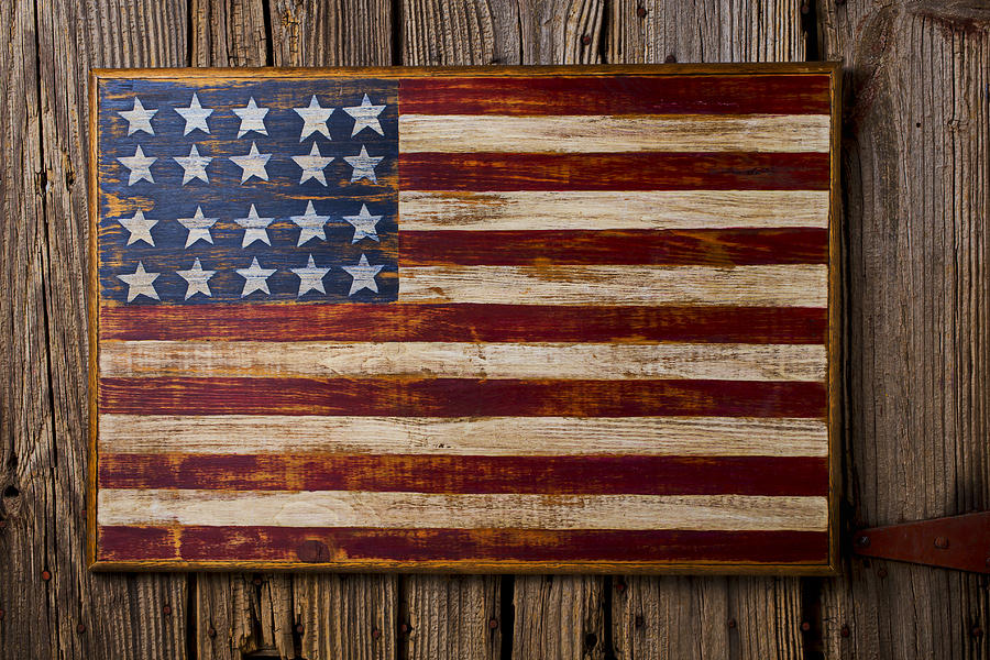 American flag painting applied to reclaimed barn wood for a unique weathered look