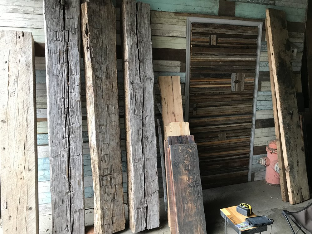 Used and reclaimed barn wood siding boards beams and other unique building materials