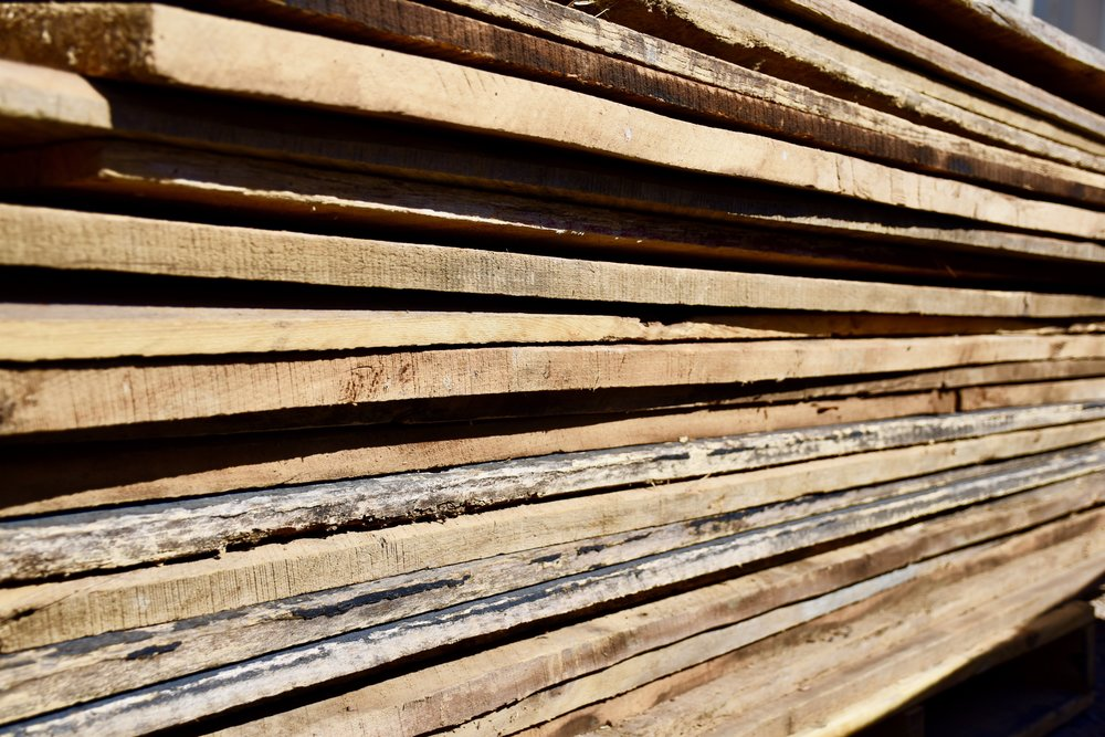 Stacks of reclaimed barn wood boards from the Coast to Coast Barnwood yard