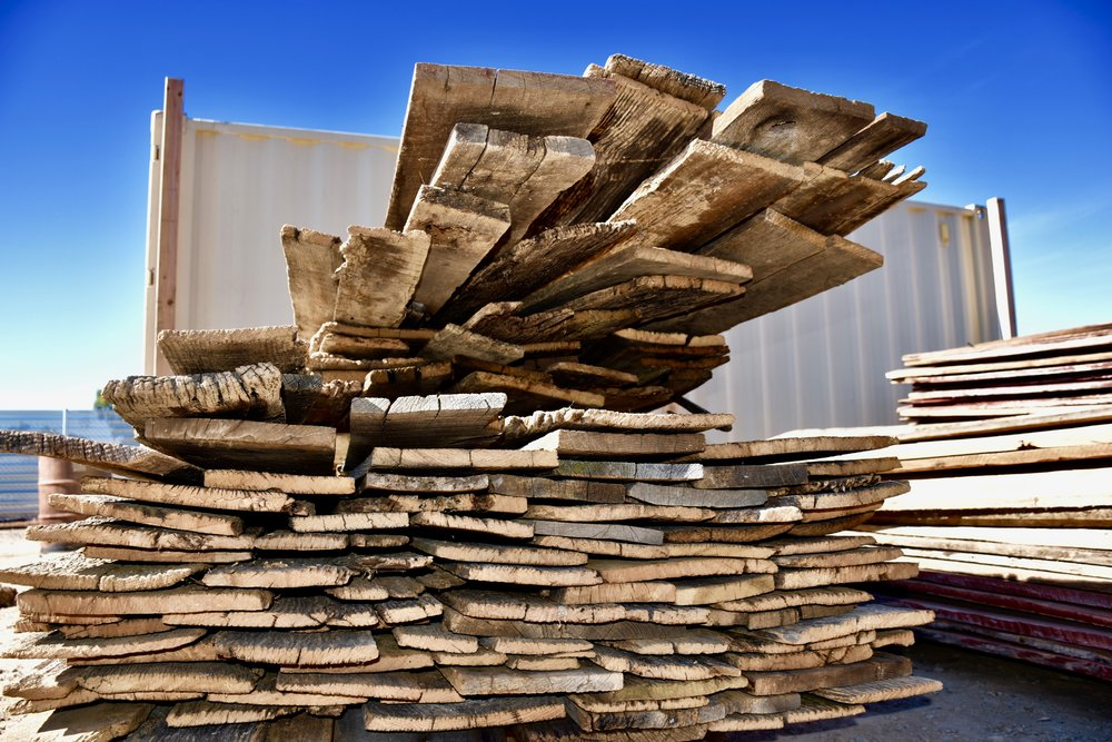 Stacks of reclaimed barn wood siding from the Coast to Coast Barnwood yard