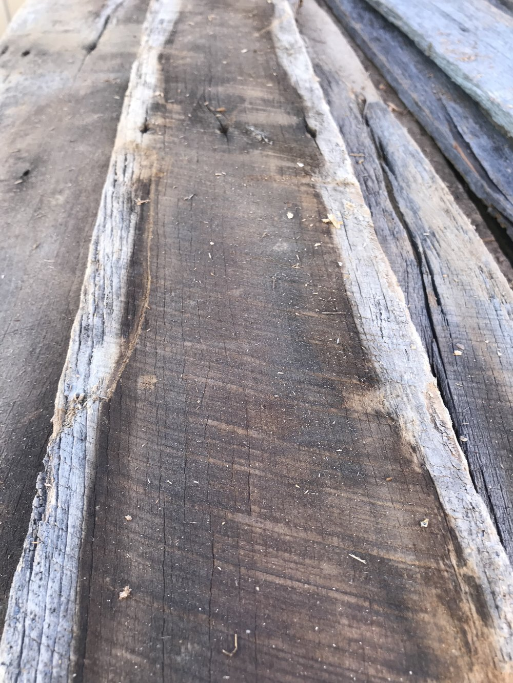 Used black and deep brown barn wood siding with natural weathering