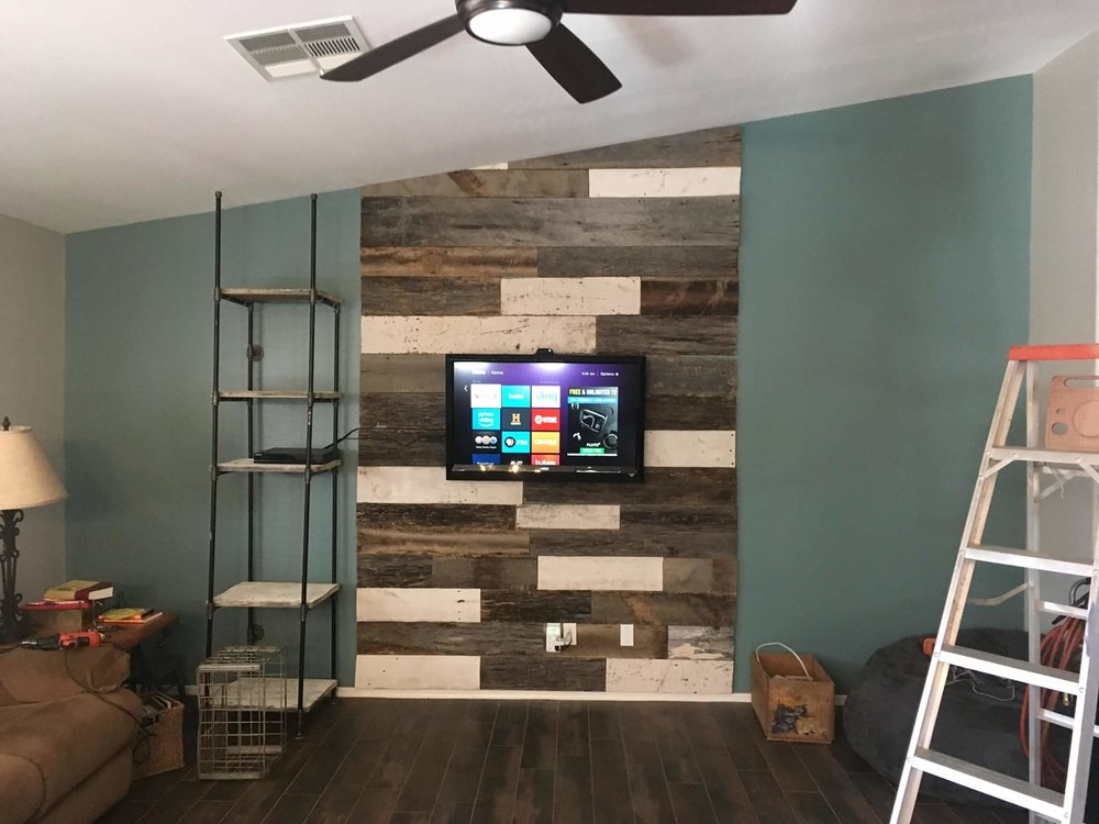 Reclaimed barn wood accent wall cover applied as a media center piece