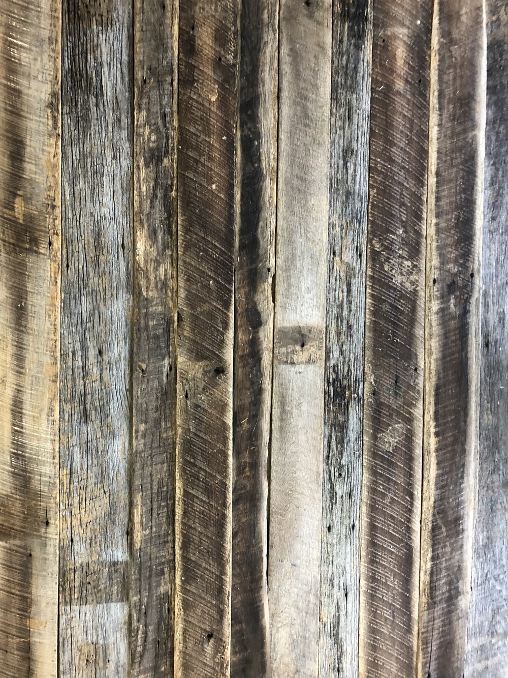 Thin weathered barn siding natural grays browns blacks