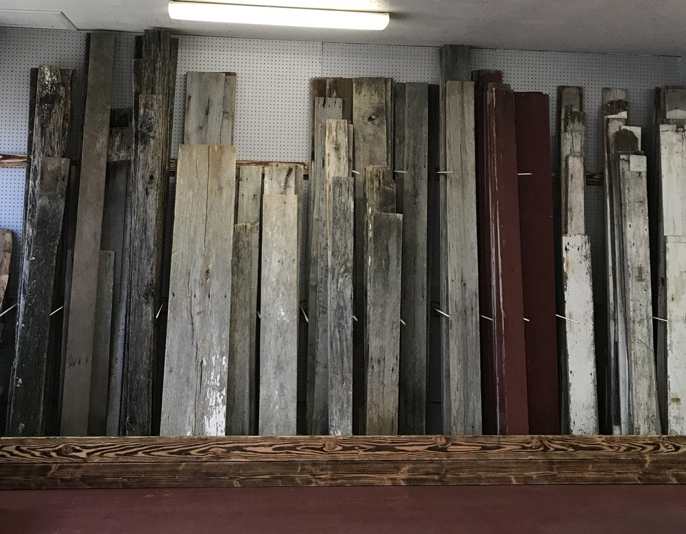 Coast to Coast Barnwood retail lumber rack with a variety of sizes and colors