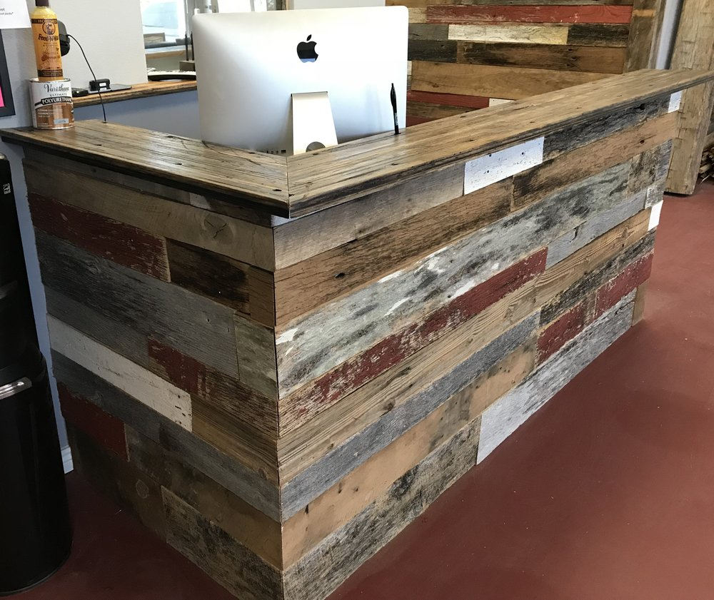 Coast to Coast Barnwood showroom reclaimed wood front desk