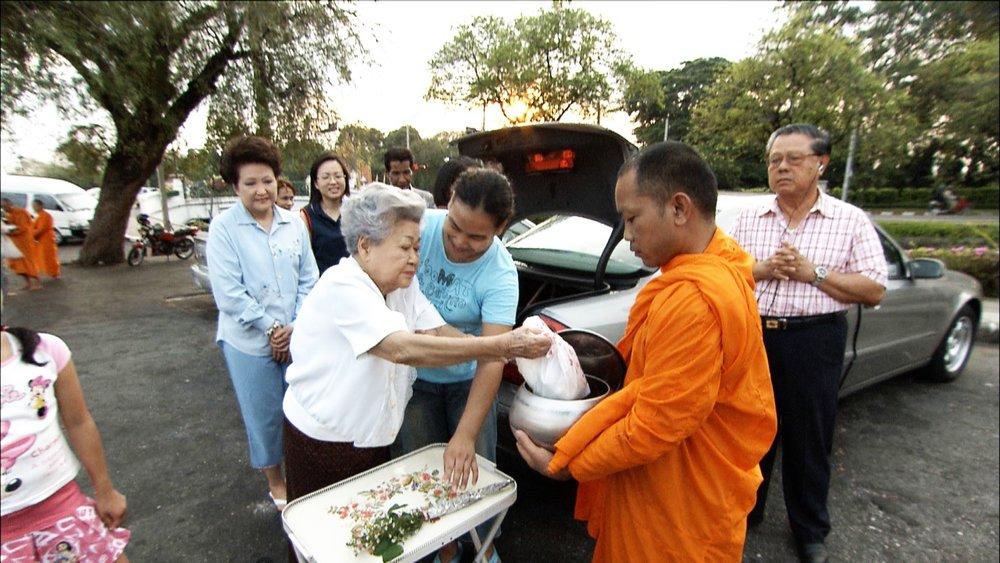 FFOTW_114_giving food to monk.jpg
