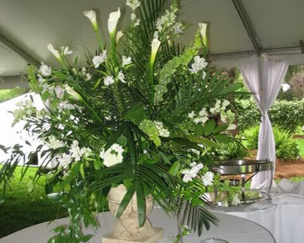 white-callas,bells-of-Ireland,snapdragon,Italian-ruscus,palm-fronds,alstromeria-and-roses.jpg