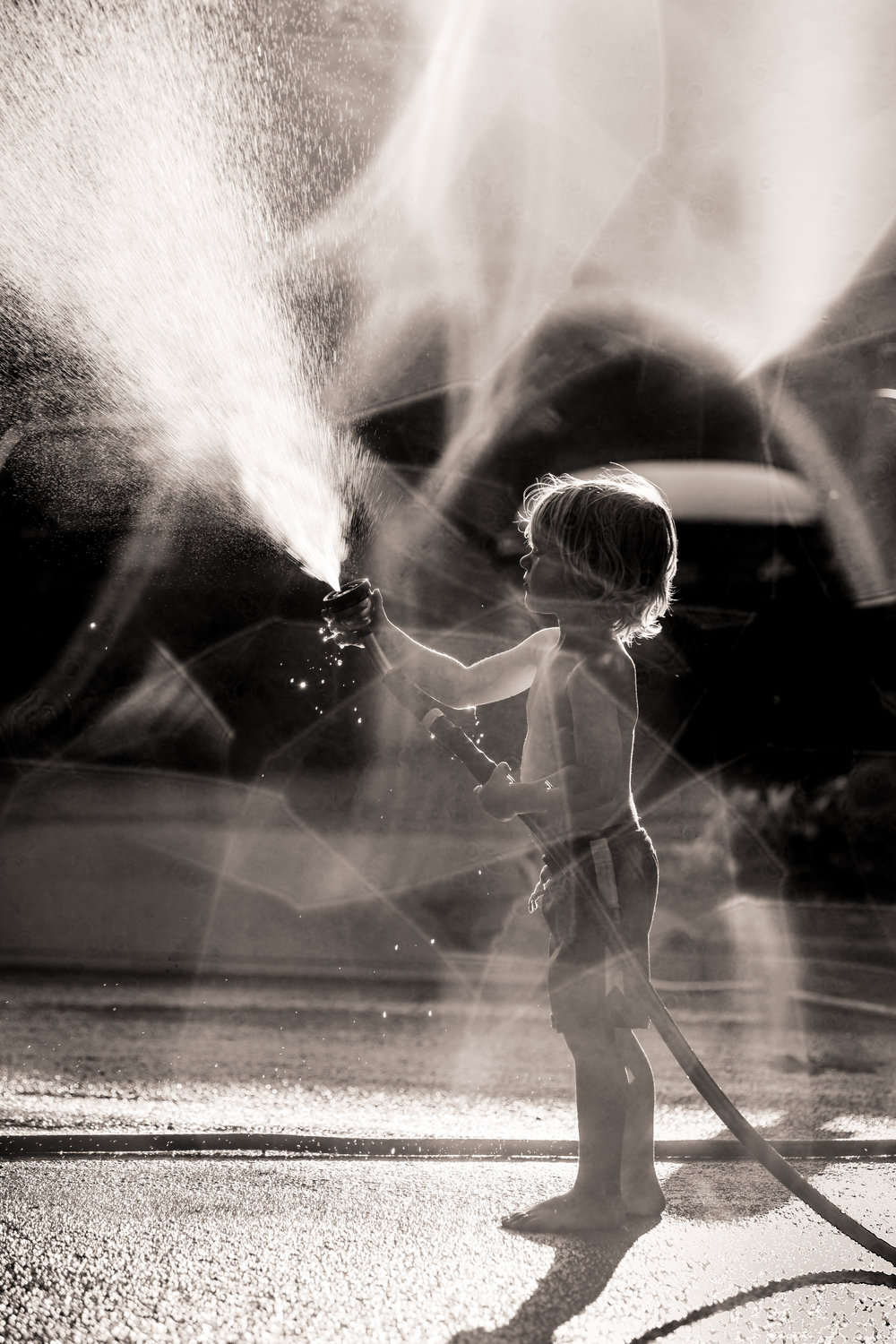 Hanging out with my favorite neighbor and model playing with the hose .
