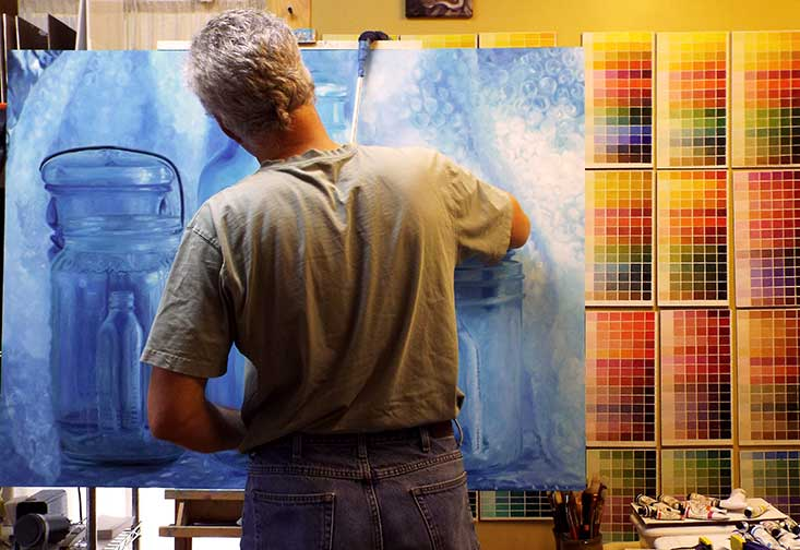 Michael Steddum - in his studio painting a water color.