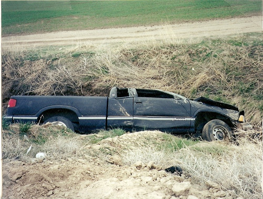 Rollover - My truck rolled three times before it was suddenly stopped by the irrigation canal