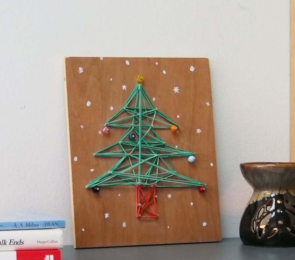 Stringle Bells - Christmas String Art   Get into the festive spirit and deck the halls with something different this Christmas! Create your very own fir tree, snowflake or snowman artwork using upcycled wood, while learning to work with nails and using easy-to-follow hammering techniques. Materials used include yarn (or coloured bands), nails, beads and paint.  - Recommended for ages 6 & up. Fees: $65 Duration: 3 hours