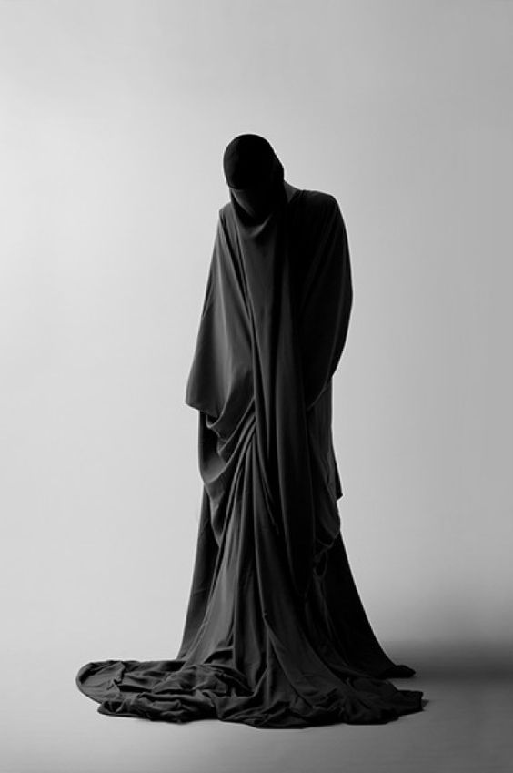 death - Death is dressed in a black robe. Genderless and featureless.