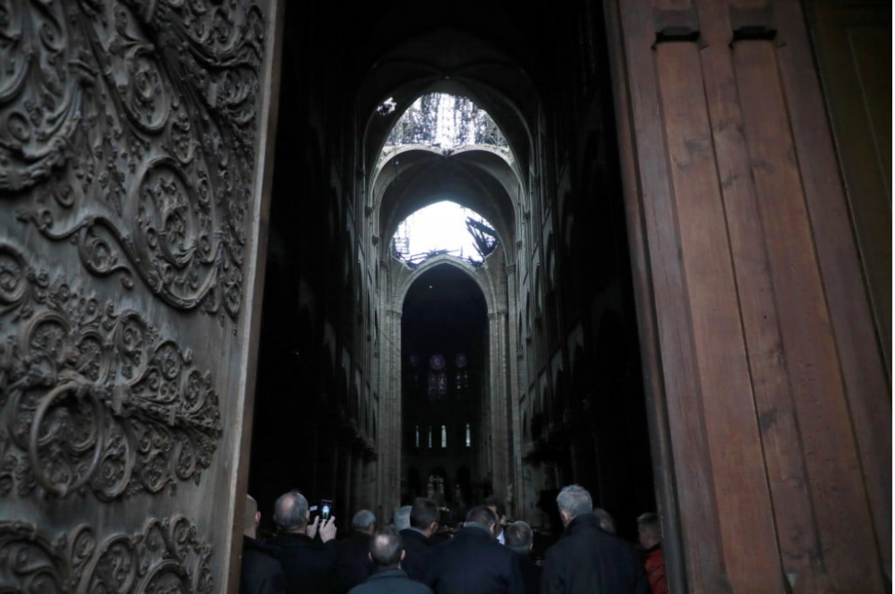 Interior with holes in roof (photo credit Christophe Petit Tesson/AP)