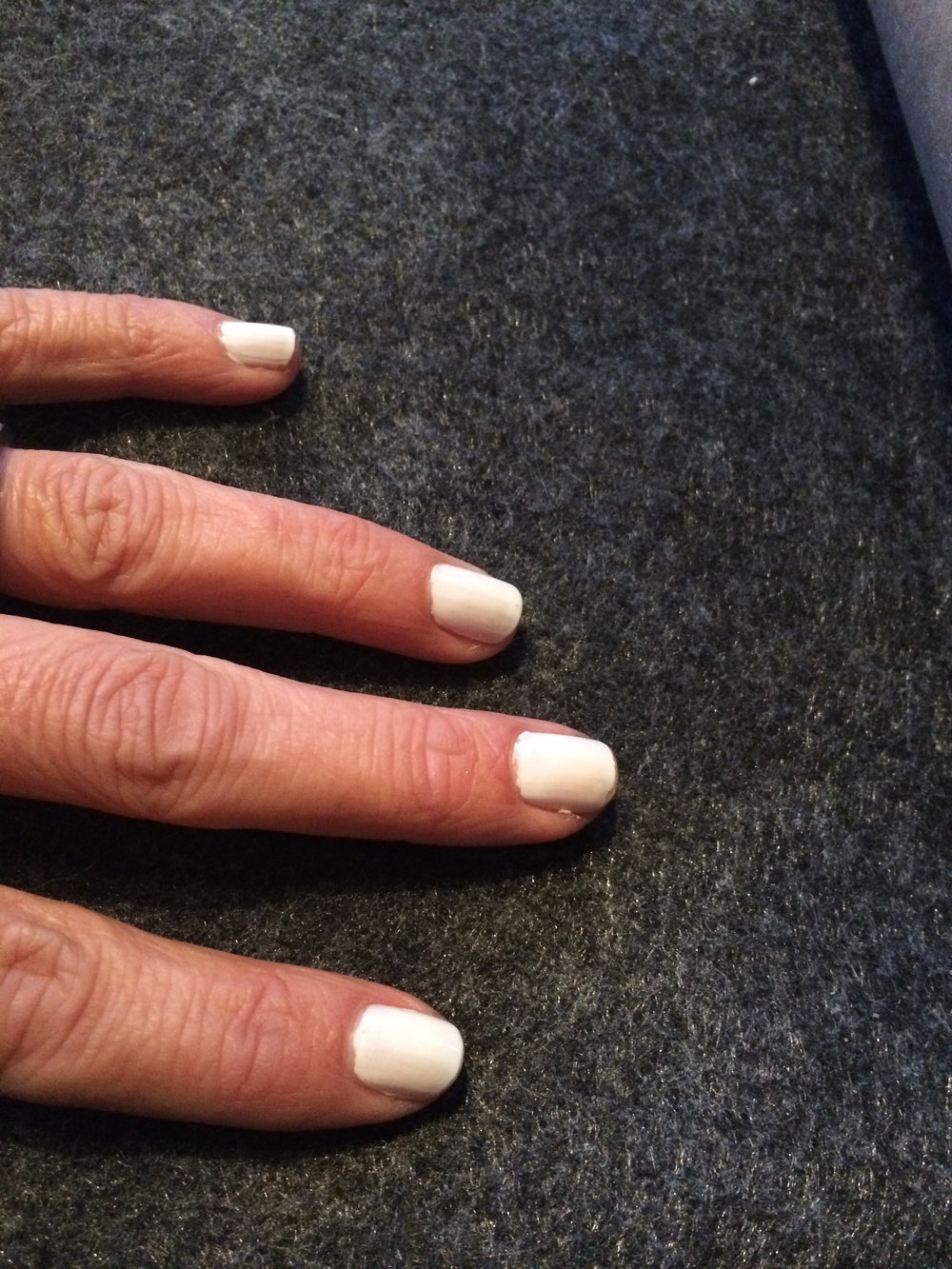 My white nails 1 week after my manicure using Covergirl Snow Storm & Deborah Lippman as a base and top coat.