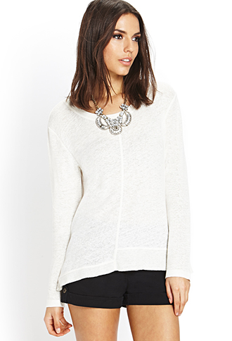 Front and center seam sweater. Available in cream or blue. Forever 21. $14.80.