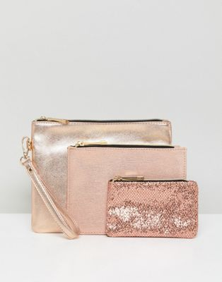 Oasis Glitter And Metallic Pouches. ASOS. $40.