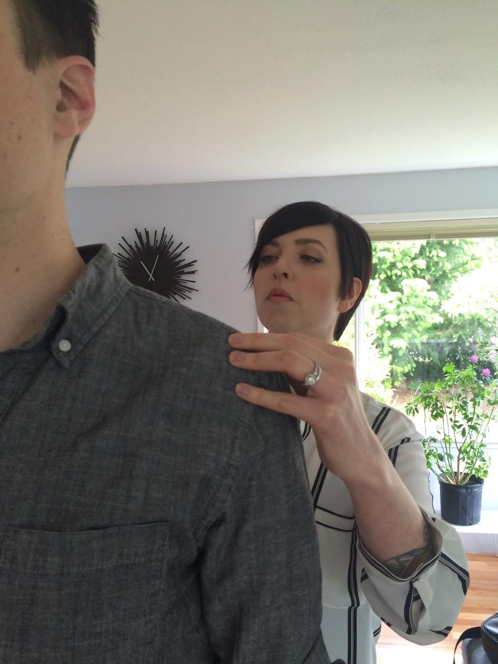 J.Hilburn stylist Ashley Bachelder taking measurements.
