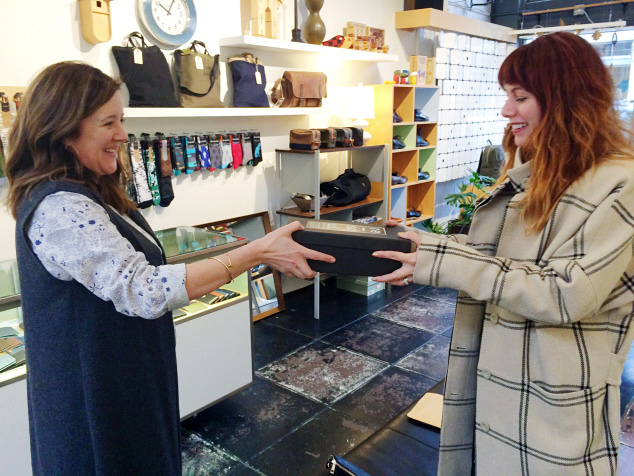Giving in action! Here's re-souL owner, Maggie handing over a brand new pair of shoes to benefit our styling session at YouthCare. As an aside, did you notice those awesome socks in the background?