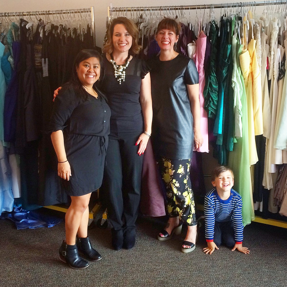 The dress code for volunteers is all black with a pop of color. Here I am with the team and an extra special helper for the day.