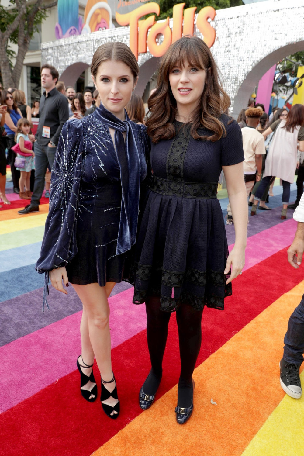 Anna Kendrick & Zooey Deschanel making the case for opaque tights versus a bare leg. It's all about what you are trying to communicate.