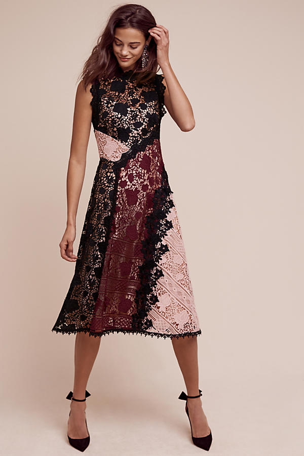 It's time to party. Opera Lace Dress. Anthropologie. $628. Additional 20% off dresses with code: WINWIN.