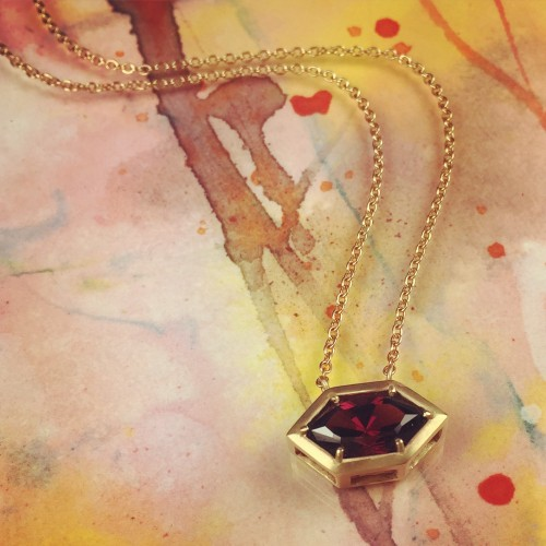 A pendant by  Rebecca Overmann  with 4.13 ct custom cut pointed rhodolite garnet in 14k gold.